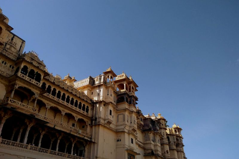 Low angle view of historical buildings against clear blue sky