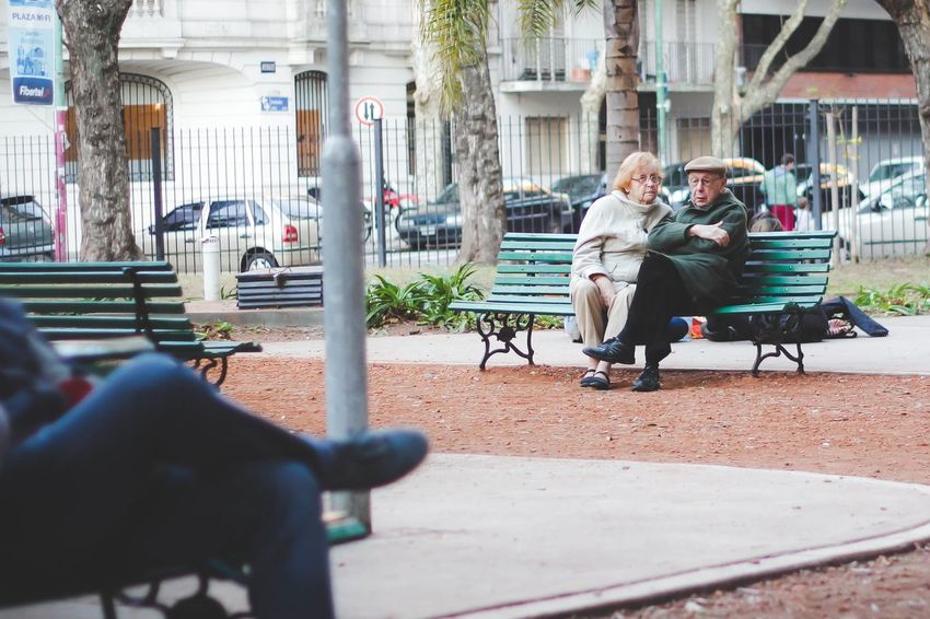 Love never gets old Couple Leisure Activity Lifestyles Love Outdoors Park Sitting Street Photography Winter