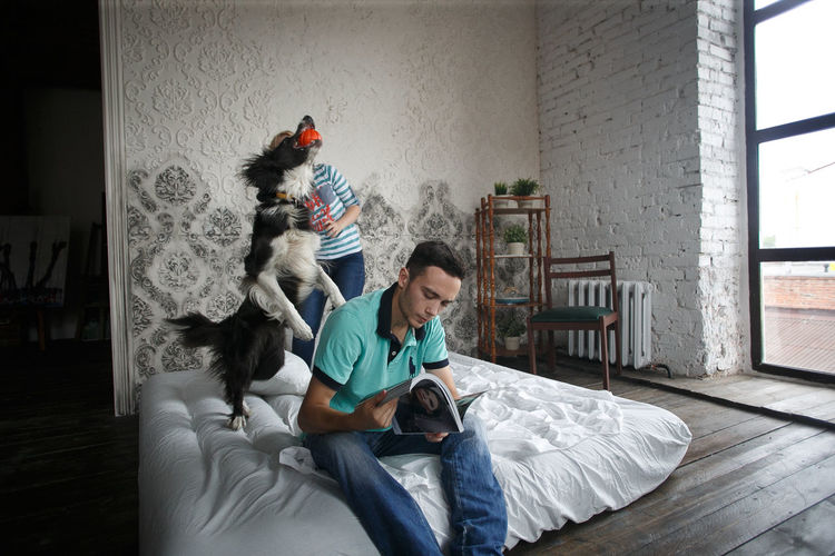 EyeEmNewHere Relaxing Taking Photos Bed Bedroom Day Dog Domestic Animals Domestic Life Full Length Holding Indoors  Leisure Activity Lifestyles Men Pets Real People Sitting Togetherness Two People Young Women