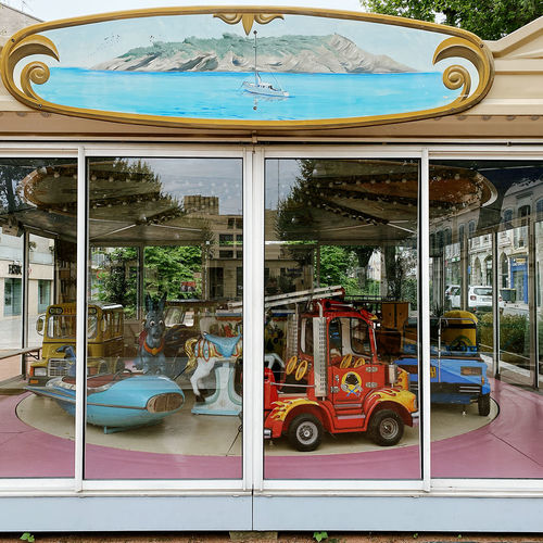 Reflection of carousel in amusement park