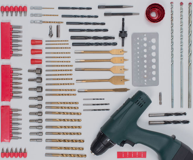 Drill tool accessories in Flat Lay Still on white Drill Tool Industrial Isolated Machine Accessories Cut Out Metal Drill Bits Drill Set Drill Steel Drills Hole Masonry Drill Bits Metal Drill Tools Twist Drill Wood Bits