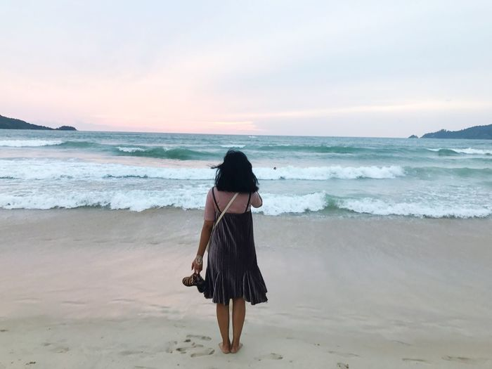 Cloudy sunset Sea Beach Sand Horizon Over Water Shore Real People One Person Nature Rear View Wave Beauty In Nature Water Scenics Walking Standing Leisure Activity Sky Women Sunset Full Length Done That. Done That.
