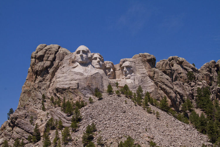 Low angle view of mt rushmore national monument against clear sky
