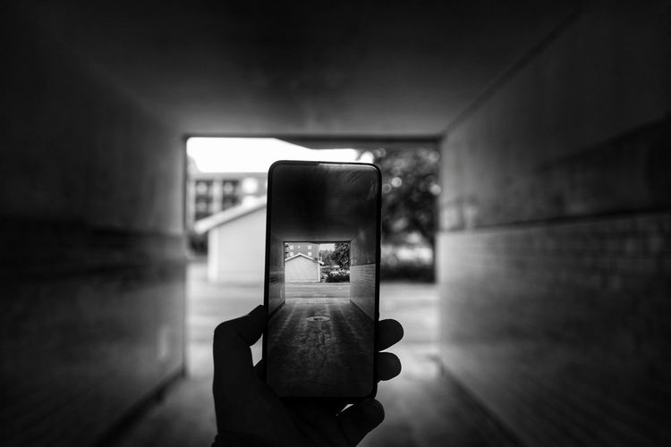 Person photographing with mobile phone