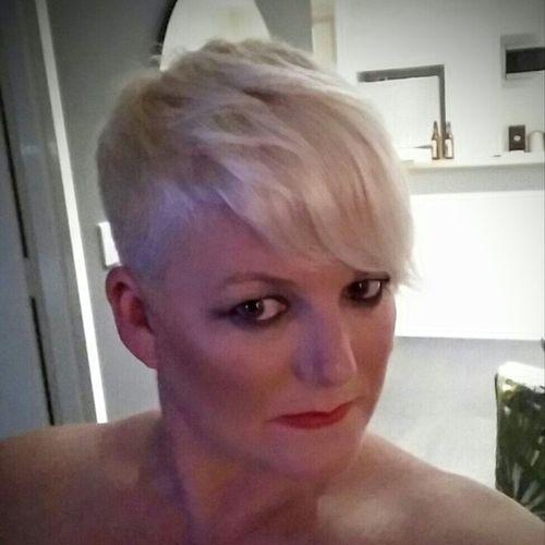 21st Century Blonde Hair Close-up Edgy Girl Headshot Looking At Camera Loving Life  Platinum Punk