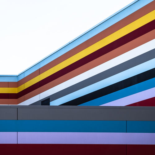 Colorfacade Multi Colored Built Structure Architecture Pattern No People Day Fujix_berlin Ralfpollack_fotografie Minimalism Minimalist Photography  Building Exterior Striped Low Angle View Sky Wall - Building Feature Design Close-up Blue Outdoors Clear Sky Yellow Building