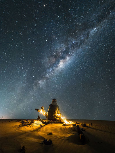 Watching the night sky EyeEmNewHere Astronomy Astrophotography Beauty In Nature Desert Galaxy Illuminated Land Landscape Milky Way Nature Night One Person Outdoors Scenics - Nature Sky Space Star Star - Space Star Field Tranquil Scene Tranquility 50 Ways Of Seeing: Gratitude Capture Tomorrow