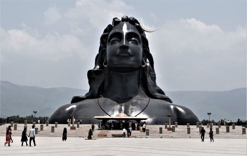 """Adiyogi Shiva Statue Designed by Sadhguru Jaggi Vasudev Statue Height: 34 mtr (112 ft) this statue has been recognized by the Guinness World Records as the """"Largest Bust Sculpture"""" in the world. I captured this picture at Isha Yoga.. #statue Sky Sculpture Statue Representation Art And Craft Travel Destinations Architecture Human Representation Cloud - Sky Group Of People Travel Nature Large Group Of People Monument Tourism The Past Day Crowd Memorial History Outdoors"""
