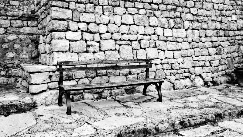 Bench Built Structure Architecture Stone Wall Stone Material Footpath Outdoors Brick Day Empty No People Eyeemphotography EyeEm Best Shots Monochrome Photography Monochrome Blackandwhite Picoftheday Dalmatian Schwarz & Weiß Bank Old Weathered The Street Photographer - 2017 EyeEm Awards