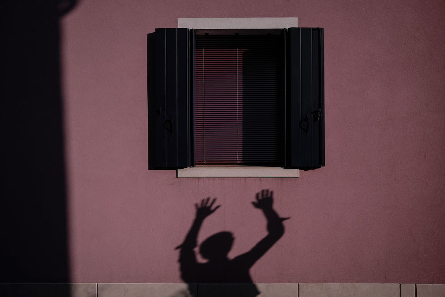 Reach - Colours Building Exterior Colourrun Day Human Hand Lifestyles Light And Shadow Real People Shadow Silhouette Sunset Window