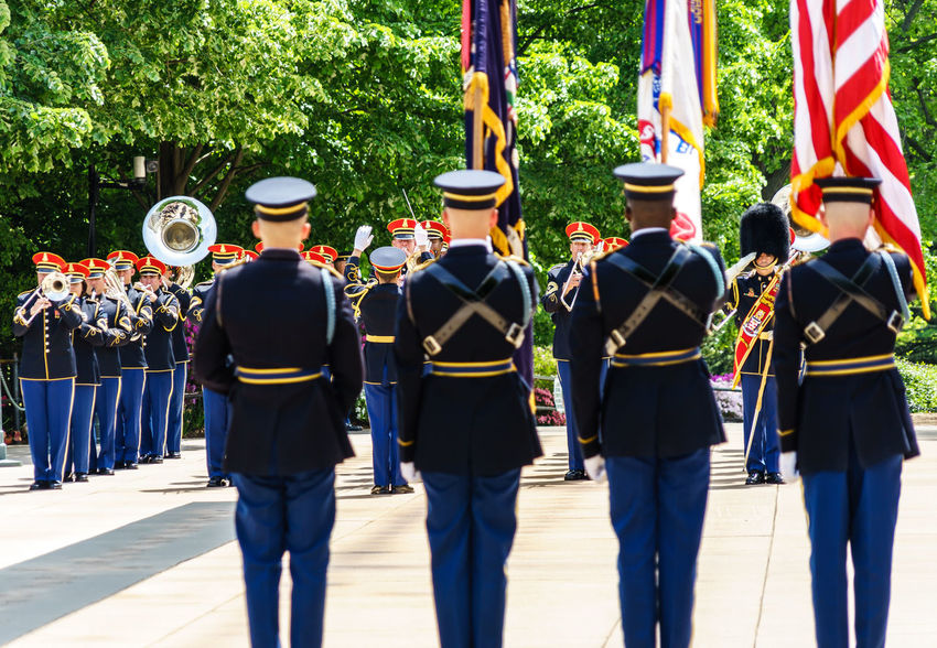 Arlington National Cemetery Armed Forces Casual Clothing Cultures Day Graveyard Heroes Honor Guard In A Row Leisure Activity Lifestyles Medium Group Of People Military Outdoors Pole Police Respect Side By Side Soldiers Tomb Of The Unknown Soldier Up Close Street Photography Washington, D. C.