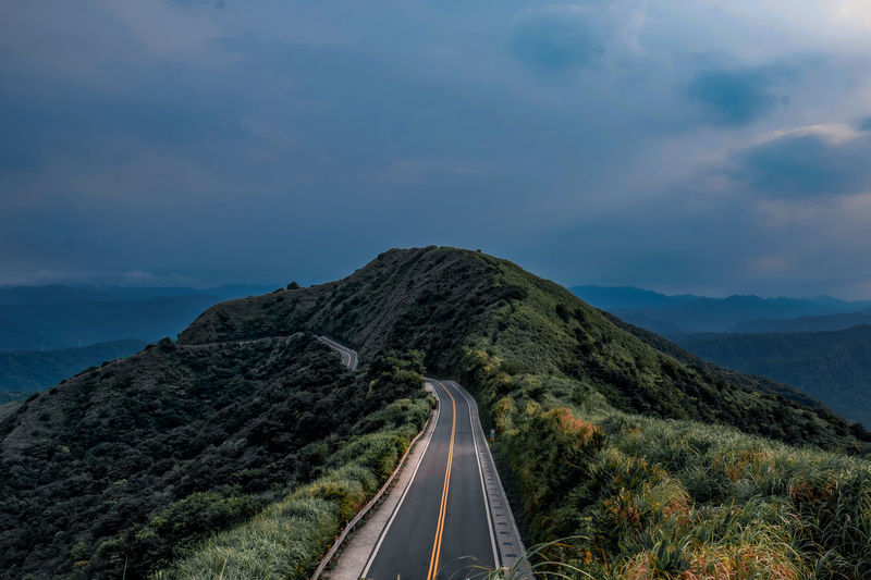 Panoramic view of road on mountain against sky