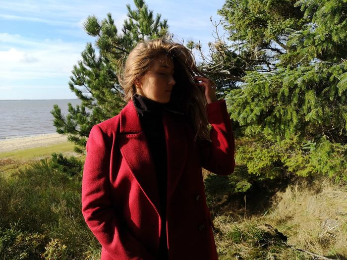 Red Woman Green Tourist Sun Light Coat Tree Young Women Water Women Standing Sky