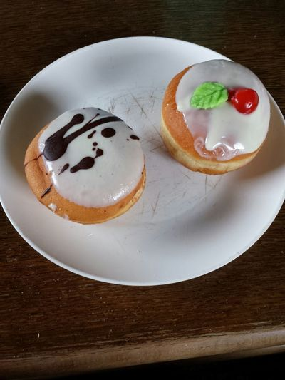 two delicious donuts one with vanilla filling and one with strawberry Food Donuts Dessert Desserts