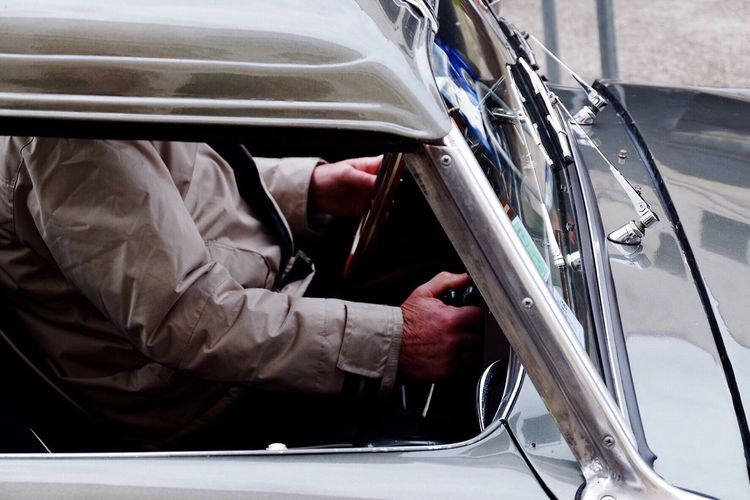 Midsection Of Man Driving Car