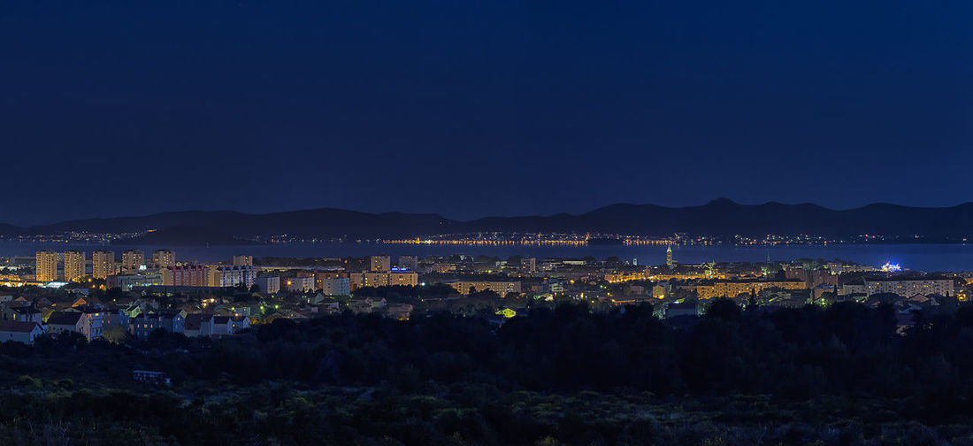 Zadar @ night (Panorama) Architecture Blue Building Exterior Built Structure City Cityscape Clear Sky Copy Space Dusk Illuminated Mountain Mountain Range Nature Night Outdoors Residential Structure Scenics Sky Tranquility Water