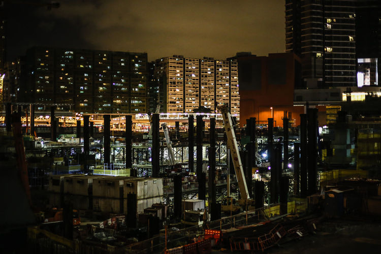 Construction Site Against Sky In City At Night