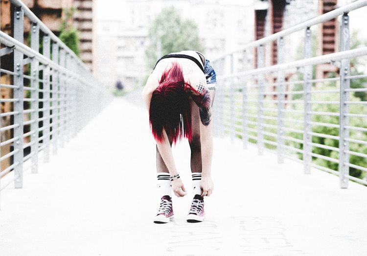 Full Length Of Woman Tying Shoe