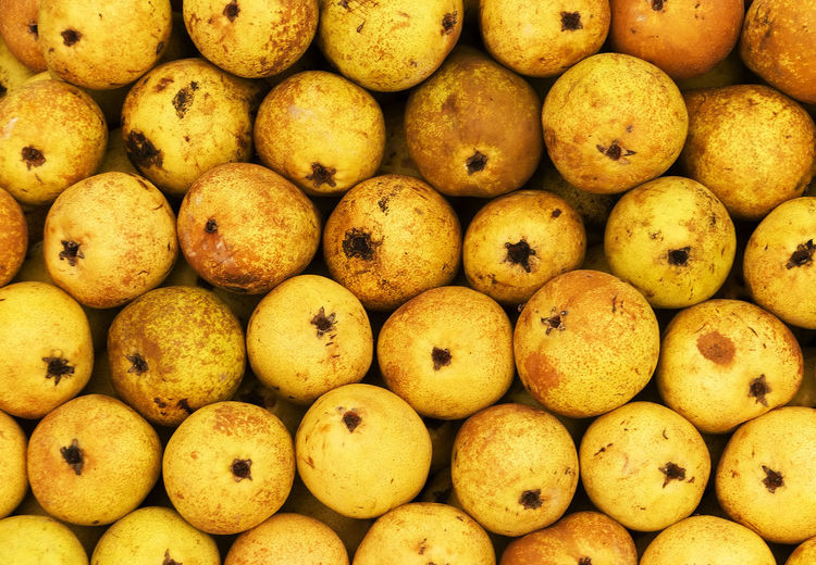 Full frame shot of quinces for sale at market