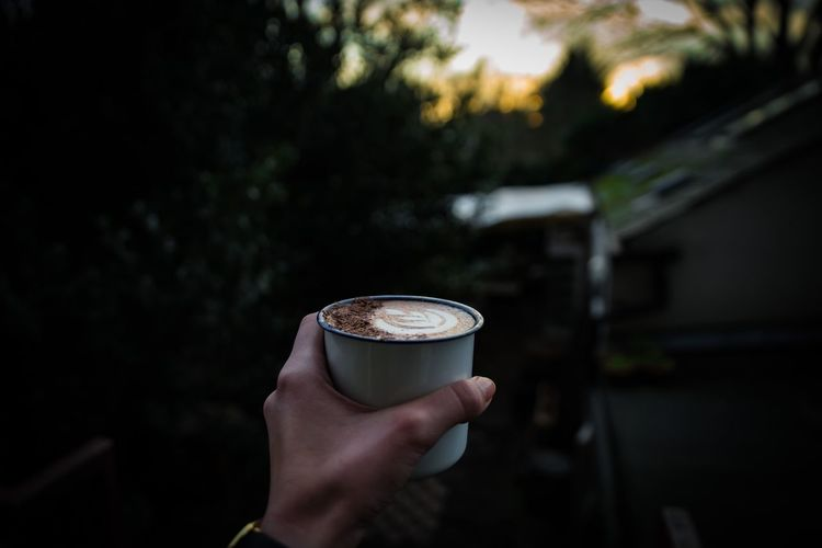 Sunset & hot chocolate Hot Chocolate EyeEm Selects Human Hand Hand Holding Drink Human Body Part One Person Refreshment Food And Drink Real People Coffee Cup Coffee - Drink Focus On Foreground Mug Unrecognizable Person Coffee Cup Lifestyles Personal Perspective Freshness Day