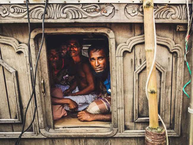 Packed like Sardines Bangladesh Bangladesh 🇧🇩 Bangladeshi EyeEm Best Shots EyeEm Gallery EyeEmNewHere Peeking Through Portraits Travel Travel Photography Bamboo - Material Boat Chittagong Crammed Eye4photography  Group Of People Men People People Photography Portrait Real People Streetphotography Window Window Frame Wodden Texture