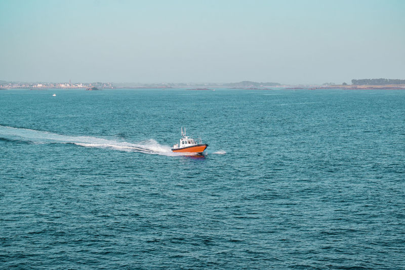 Pilot boat approaching from the coast across the sea