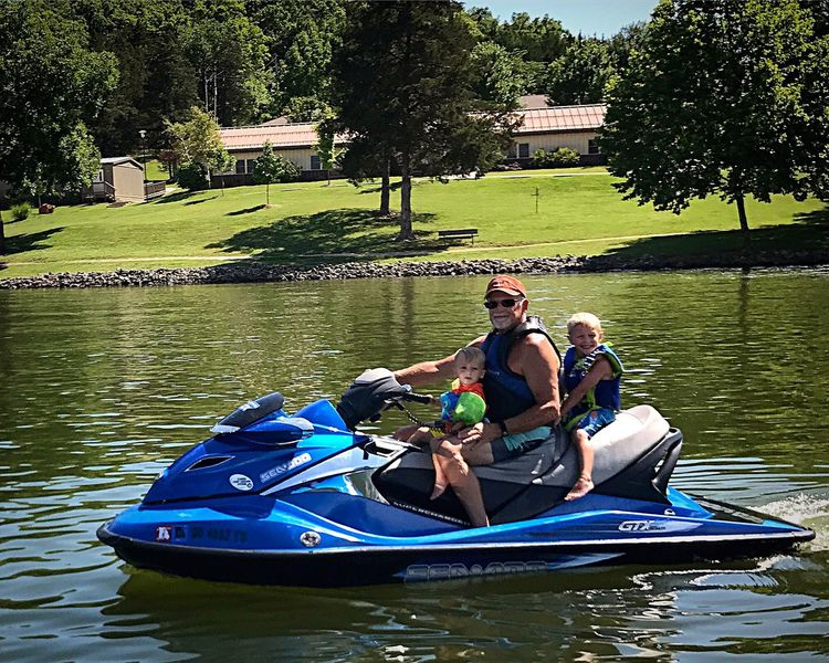 Two People Togetherness Water Leisure Activity Vacations Mid Adult Adult Grandpa grandsons Wave Runner Lake Weekend Activities Outdoors River Oar Day Adventure Nature Sitting Full Length