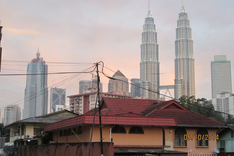 Architecture City Travel Destinations Building Exterior Built Structure Skyscraper Cityscape Travel Sky City Life Urban Skyline No People Tourism Outdoors Sunset Downtown District Bridge - Man Made Structure Modern Business Finance And Industry Day Old Buildings Old And New Architecture Kuala Lumpur Malaysia  Sunset View. City Life