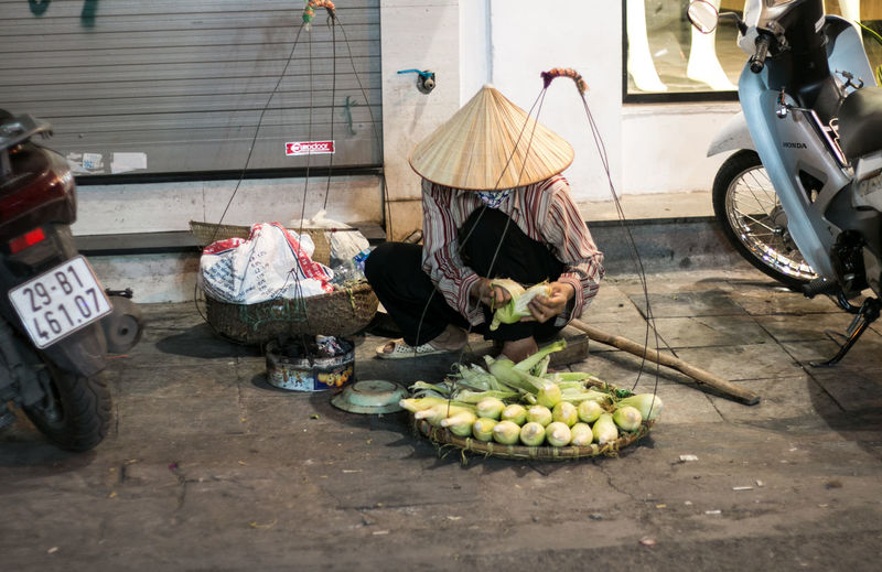 Working Woman Woman Streetphotography Street Photography Food Food And Drink Healthy Eating Mode Of Transportation For Sale Vegetable Wellbeing Street Market Freshness Fruit Incidental People Small Business Preparing Food Land Vehicle People Transportation Real People Buisiness Vietnam Hanoi