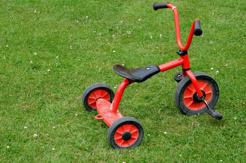 A really old photo I took of a trike in York. Childs Bike Close-up Grass Lawn No People Outdoors Plaything Red Tricycle Trike