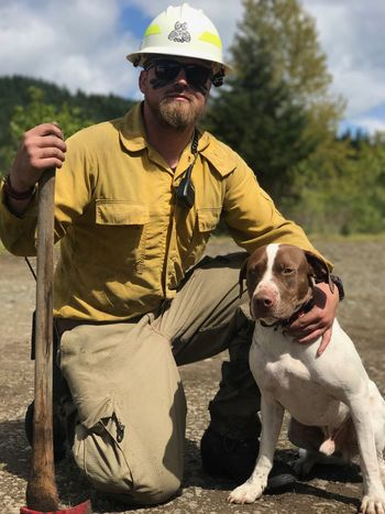 Wildlandfirefighter One Person Dog Casual Clothing Pets Outdoors One Animal Mammal Day Real People Sitting Domestic Animals Men One Man Only Nature Only Men Sky Adult Adults Only People Firedog English Pointer Mix