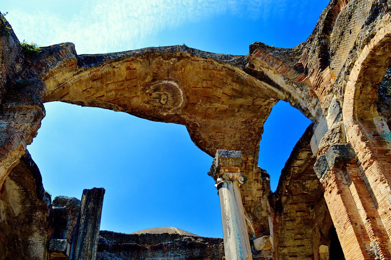 old ruin, arch, rock formation, damaged, deterioration, history, rock - object, abandoned, low angle view, natural arch, bad condition, weathered, no people, day, nature, run-down, tranquility, architectural column, blue, architecture, travel destinations, outdoors, sky, scenics, beauty in nature, ancient civilization