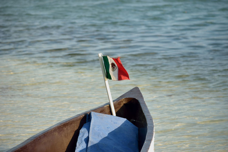 Close-Up Of Flag In Boat On Sea