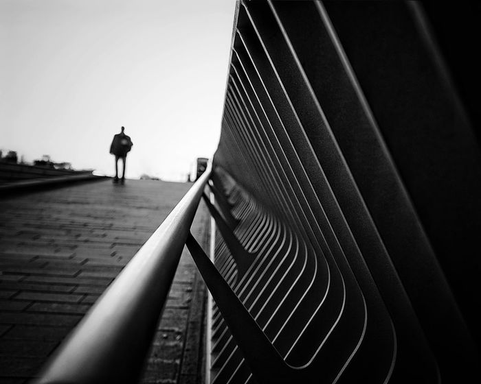 Noir Noir Et Blanc Architecture One Person Real People Built Structure Men Sky Day Outdoors Leisure Activity Silhouette The Way Forward Walking Unrecognizable Person Building Exterior Railing Lifestyles Full Length Clear Sky Nature The Street Photographer - 2018 EyeEm Awards