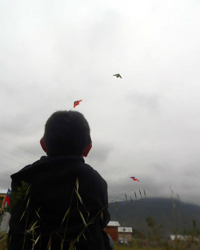 Boys Day Flying Leisure Activity Men Nature One Boy Only One Person Real People Rear View Sky