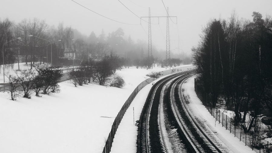 """tunnelbaneräls (it means """"metro rails"""" in swedish, you see how fast i'm learning !) Black And White Cold Temperature Emptiness Foggy I'm Fcking Freezing Out Here Snow Stockholm Sweden Tracks Train Tracks Tree Winter"""