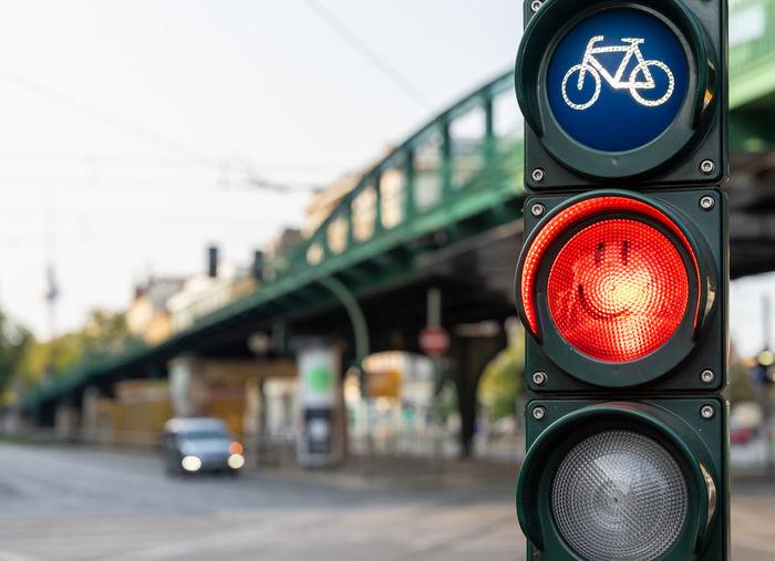 Close-up of stop light at bridge
