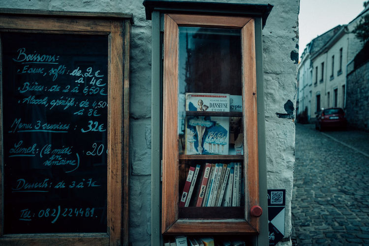 Ardennes Atmospheric Mood darkness and light Dark Eerie Beautiful Ardennen Belgium Books Bookshelf Bookstore Old Architecture Built Structure Text Communication Building Exterior No People Wood - Material Blackboard  Day Board Western Script Building Wall - Building Feature Outdoors City Window Close-up Education Script