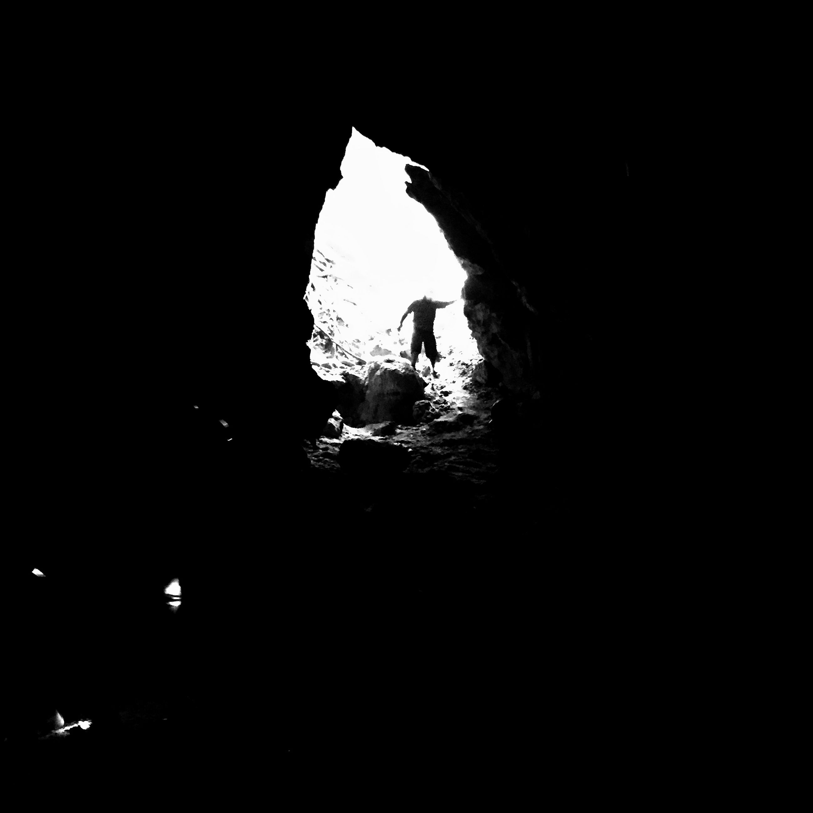 lifestyles, silhouette, leisure activity, men, full length, adventure, standing, unrecognizable person, person, low angle view, dark, nature, tunnel, sky, exploration, copy space, boys