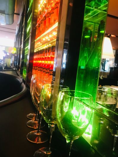 Bar Illuminated Night No People Arts Culture And Entertainment Multi Colored Lighting Equipment Close-up Glowing Green Color Glass - Material Indoors  Nightlife Reflection Bar - Drink Establishment Machinery Light - Natural Phenomenon In A Row Window