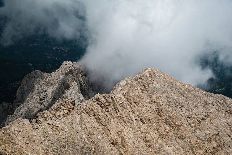 Scenic view of mountain against clouds and sky
