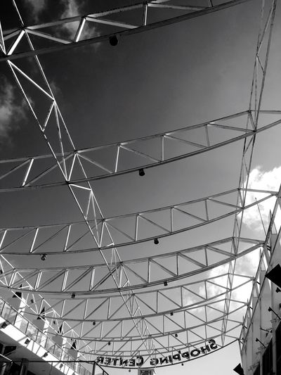 Low Angle View Built Structure Architecture Ceiling Indoors  No People Day Modern Sky Shopping Mall Mogan Holiday Roof Building Streetphotography Street Urban Grey Clear Sky Outdoors Tranquility Sky And Clouds Travel Palm Concrete