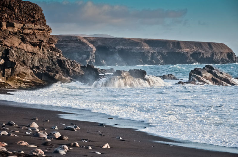 Nature always wins, 2017 EyeEmNewHere Magical Beach Beauty In Nature Blackbeach Blacksandbeach Cliff Day Horizon Over Water Motion Mountain Nature No People Outdoors Rock - Object Sand Scenics Sea Sky Water Wave