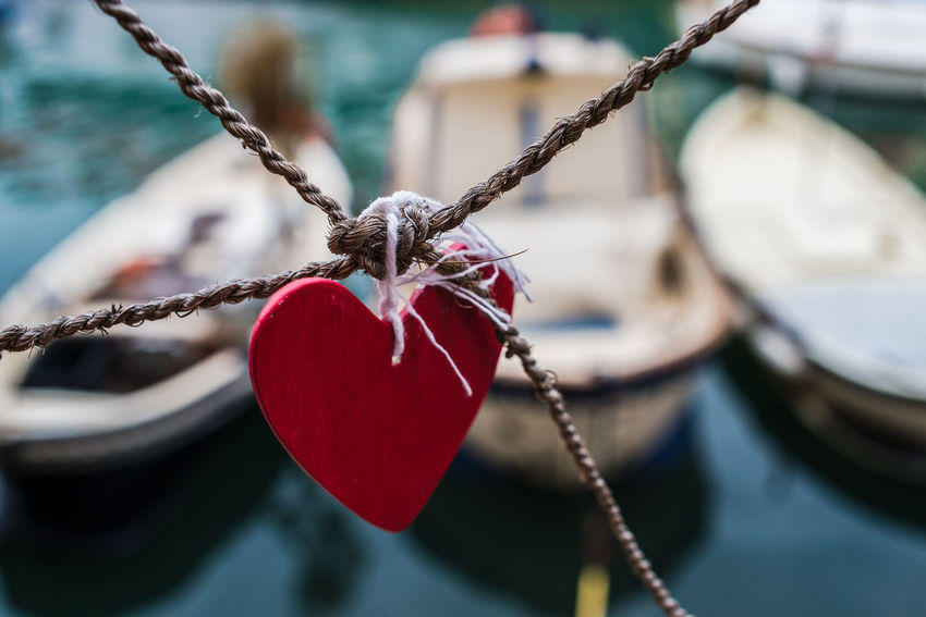 In the port of Camogli Boats Buoy Close-up Day Focus On Foreground Hanging Heart Heart Shape Hope Love Love Lock Moored Nature Nautical Vessel No People Outdoors Padlock Port Red Red Heart Safety Tied Knot Tied Up Water