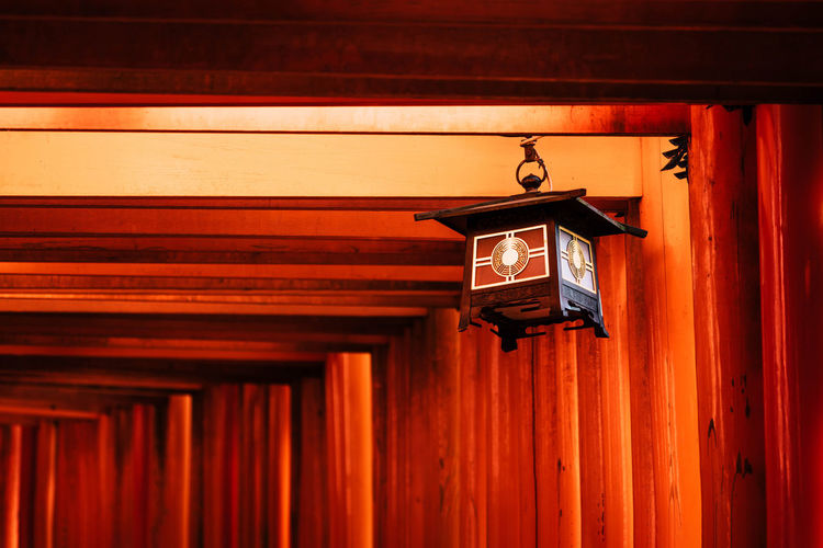 Low angle view of lantern hanging on ceiling of building