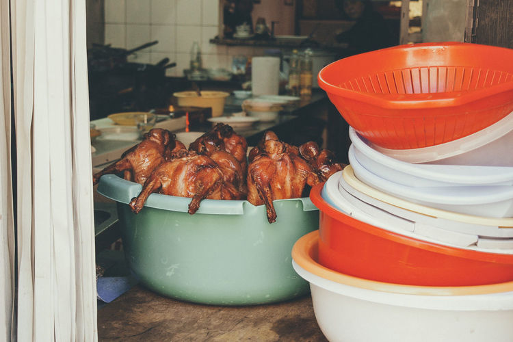 Roast chickens in container