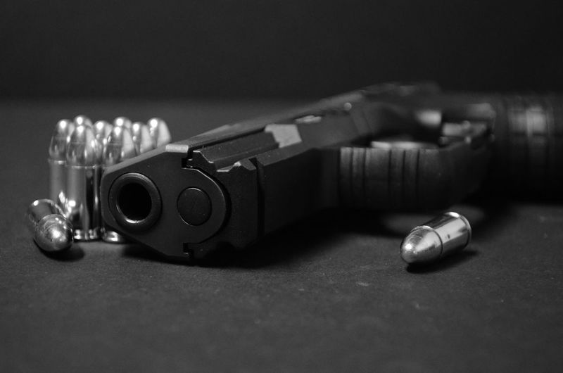 Handgun and bullets in black and white. B & W Photography Black And White Collection  Black And White Photography Bullets Close-up Focus On Foreground Handgun Low Key Black Man Made Object No People Pistol Selective Focus Still Life