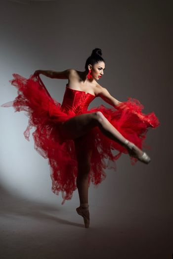 Ballet Dancer Red One Person Fashion Beauty Beautiful Woman Full Length Women Young Adult Studio Shot Indoors  Clothing Fashion Model Dress Young Women Females Dancing Looking Away Glamour Hairstyle
