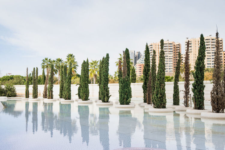 Panoramic view of swimming pool by lake against sky