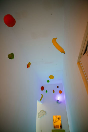 Low angle view of balloons in mid-air at home